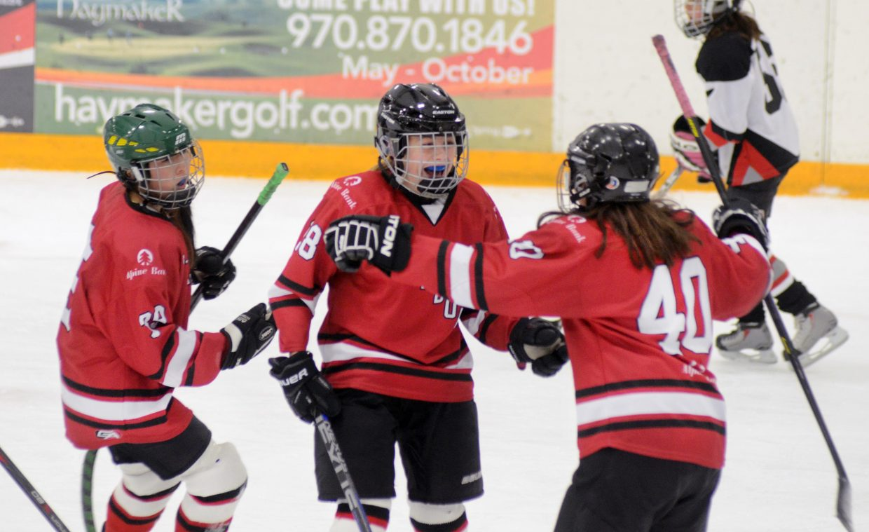 Steamboat Springs U14 girls hockey's Alicia Mitchell celebrates her goal Sunday in the Adele Dombrowski Tournament championship game.