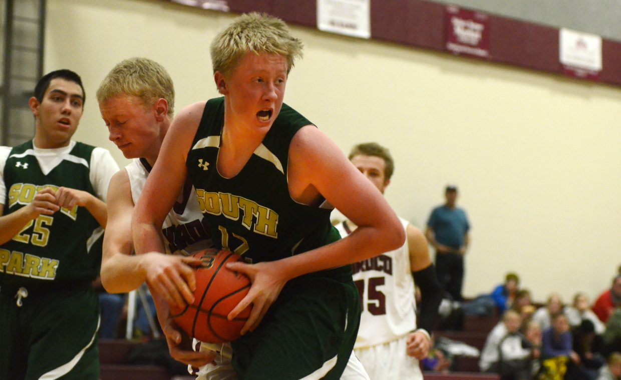 South Park's Wyatt Gould rips a rebound free from Soroco's Warren Hayes on Saturday.