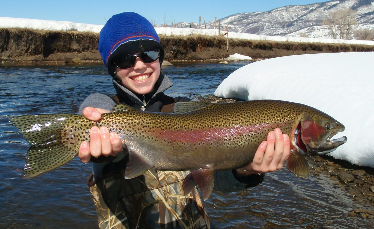 A Steamboat Flyfisher client shows off a big winter catch along a private stretch on the Yampa River during a guided trip.