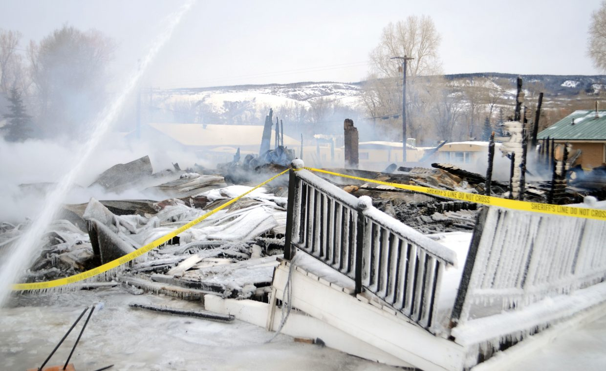 By Sunday morning, the Royal Hotel in Yampa had completely burned down, but firefighters still were on scene controlling what was left of the blaze and ashes.