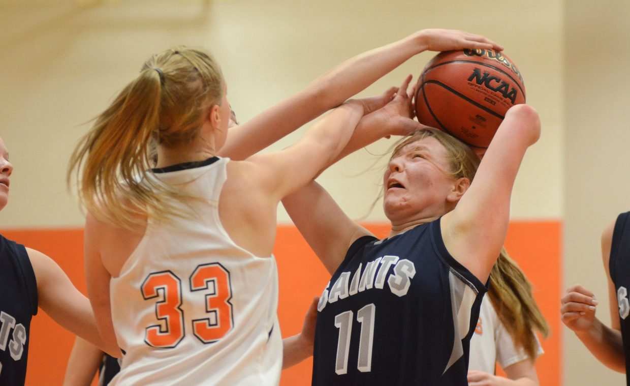 Hayden's Kenzie Fry harasses Vail Christian's Remy Beveridge Saturday afternoon in the Tigers' 40-25 loss at home.