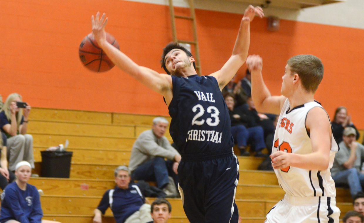 Vail Christian's Ethan Pence tries to haul in an errant pass in the second half of the Saints' win over Hayden.