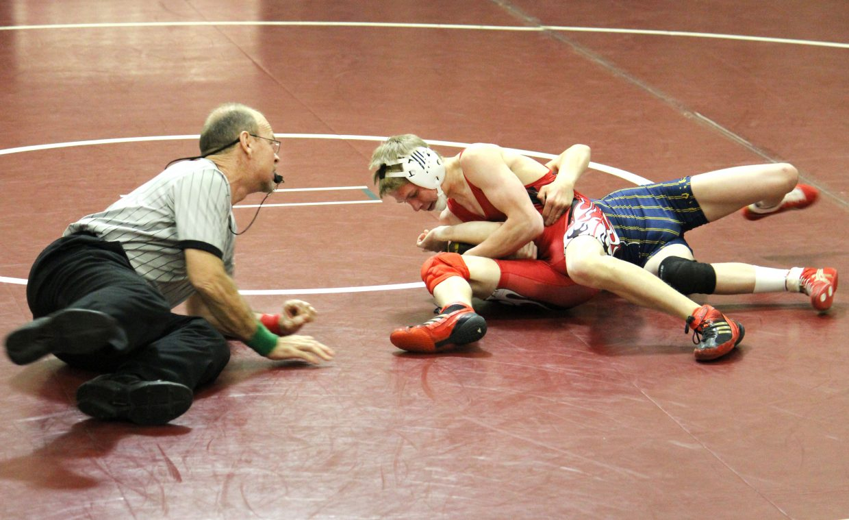 Steamboat Springs' Dakota Thvedt goes for a pin on Tuesday against his Rifle opponent. Thvedt ended up winning by pin and followed it up with another win against Palisade.