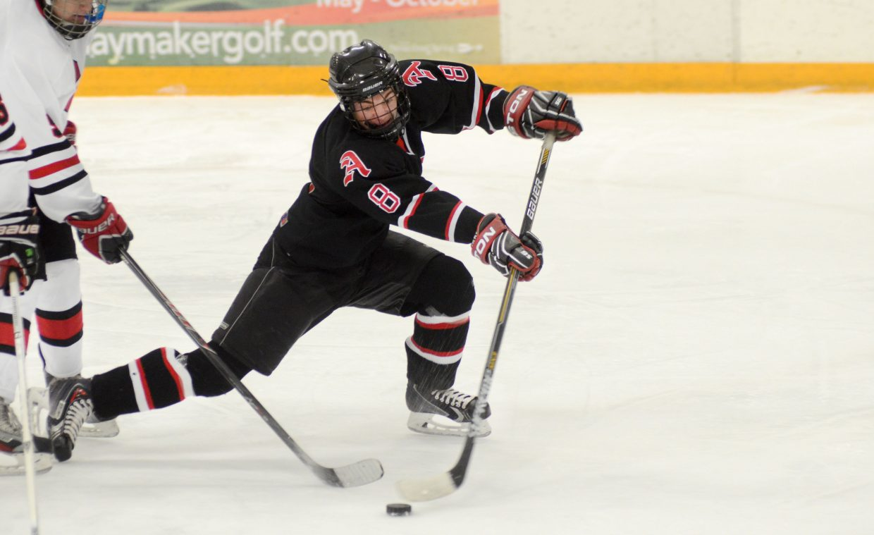 Aspen's Henry Godfrey beat the Steamboat defense in the second period Wednesday but had his shot gobbled up by Steamboat Springs goalie Jackson Draper. The Skiers' Tyler Tick, however, dropped a hat trick on the Sailors in visiting Aspen's 3-1 win.