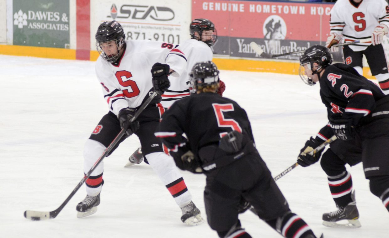 Steamboat Springs' Scott Brown tries to wiggle through the Aspen defense Wednesday night in the Sailors' 3-1 loss to the Skiers.