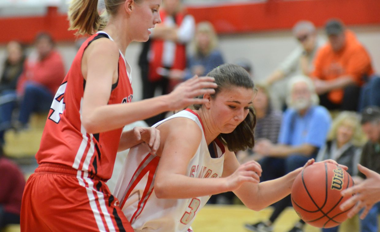 Steamboat Springs senior Savannah Bauknecht tries to get by Glenwood Springs' Madi Spence in the second half of the Sailors' 51-19 loss to the Demons. Bauknecht had a team-high six points.