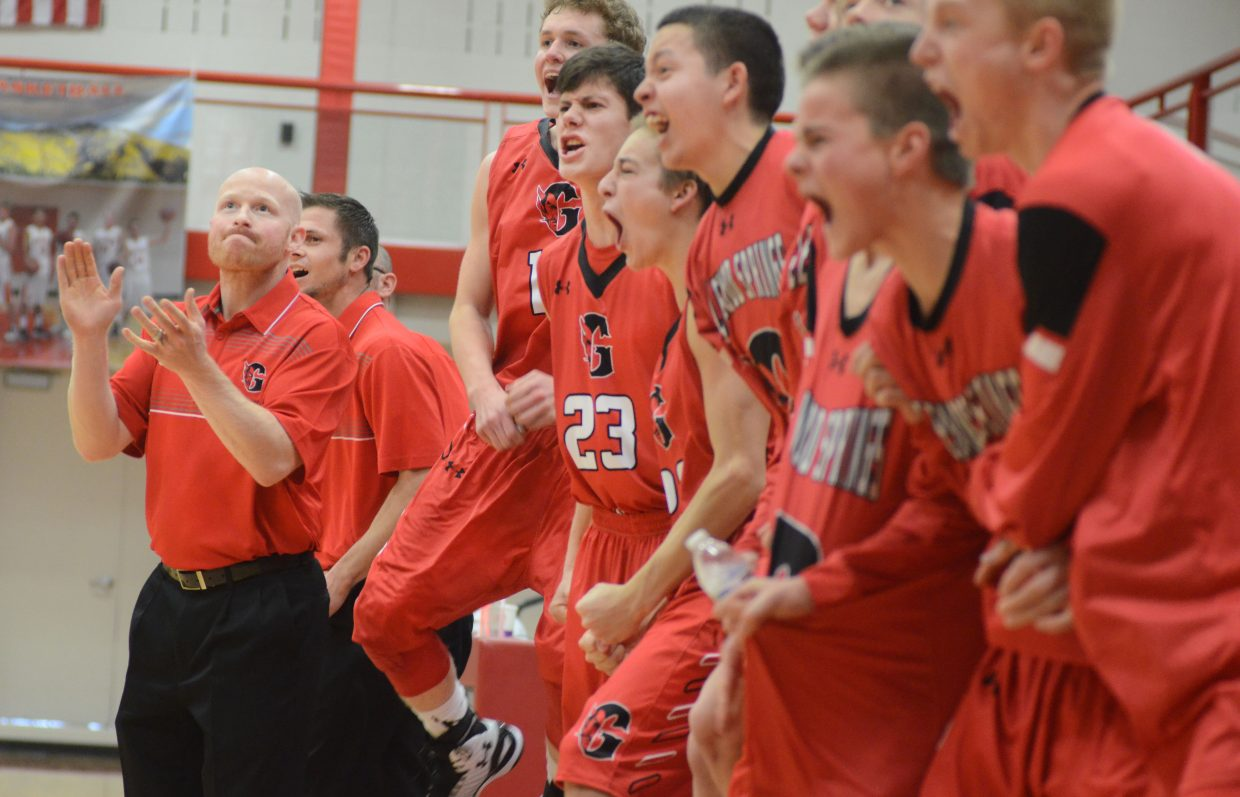 Glenwood Springs High School boys basketball coach Cory Hitchcock and his bench celebrate a late victory against Steamboat Springs on Saturday in the Sailors' gym.
