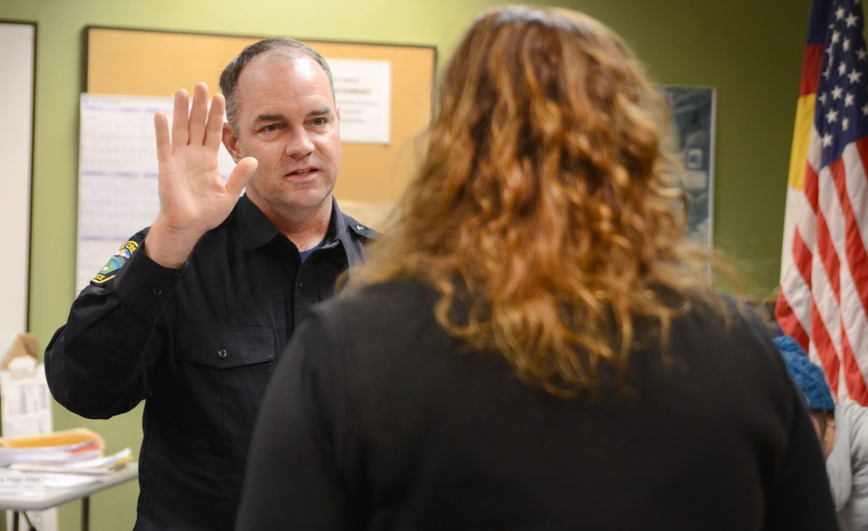 Oak Creek Mayor Nikki Knoebel swears in new police chief Ralph Maher prior to Thursday night's Oak Creek Town Board meeting. Maher brings more than two decades of law enforcement experience, mostly on the Front Range.