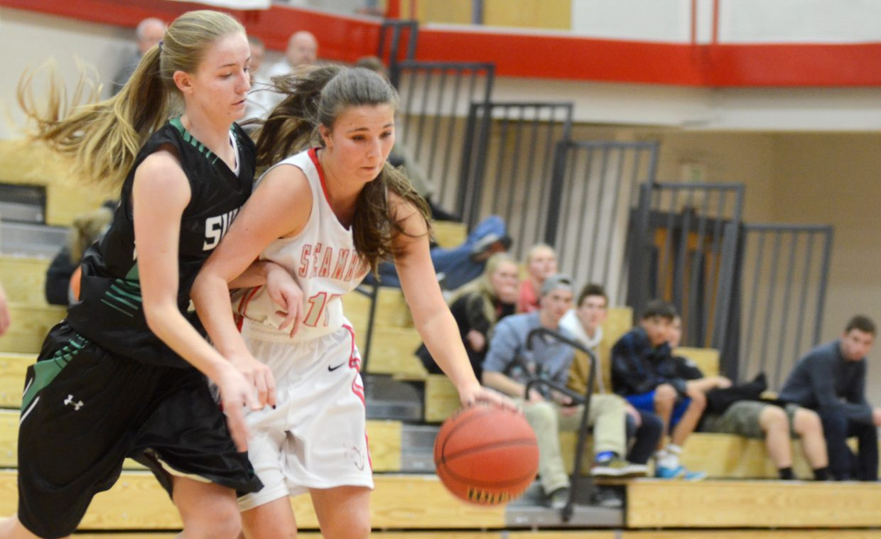 Steamboat Springs senior Savannah Bauknecht drives the lane against the Summit Tigers Friday night.