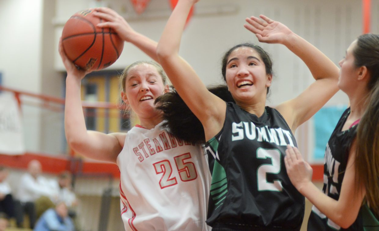 Steamboat Springs junior Jenna Miller fights for a rebound with Summit's Jessica Horii in the first half of the Sailors' 11-point loss at home.