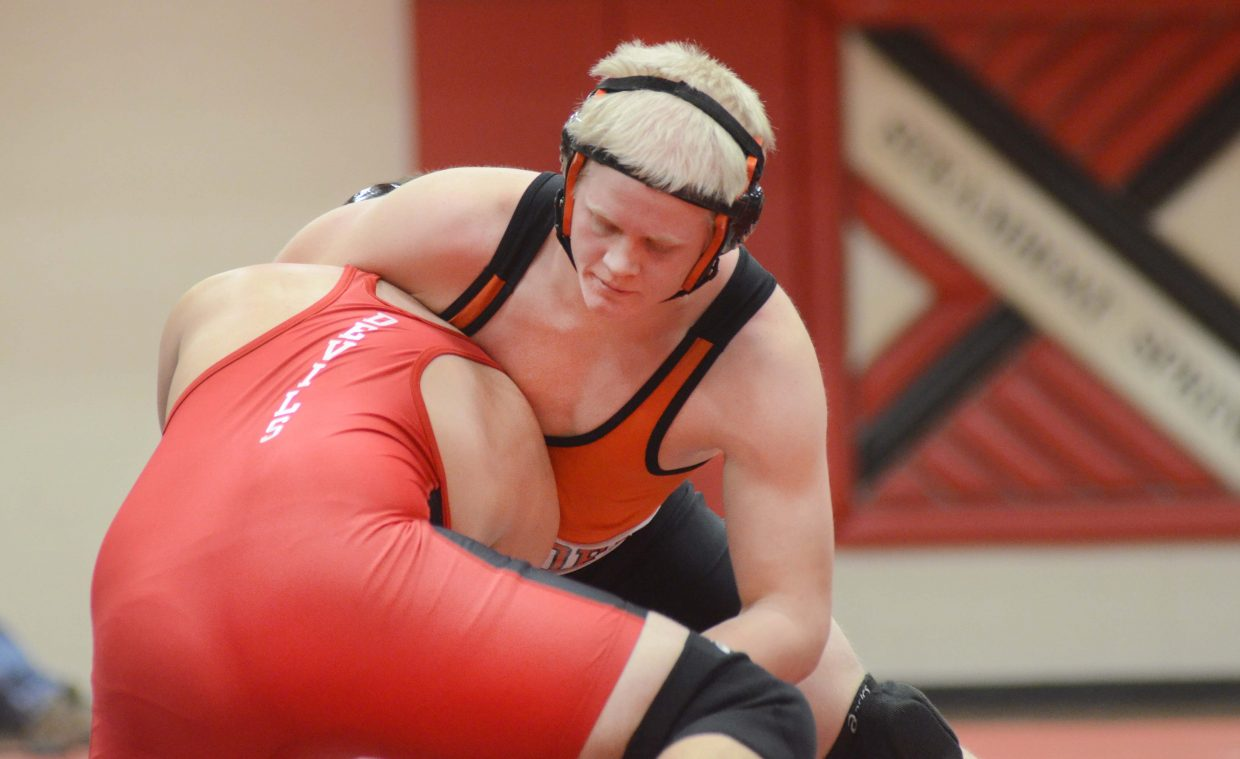Hayden's Christian Carson gets Eagle Valley's Gabriel Baldwin in a headlock in the first round at 195 pounds.