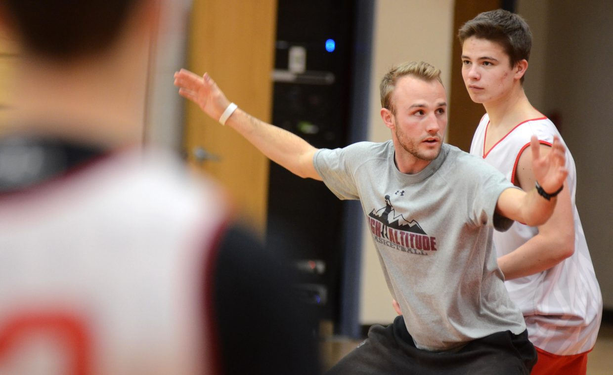 Mike Vandahl runs the Steamboat Springs High School boys team through a drill at Wednesday's practice. Vandahl, a former Sailors hoops star, started coaching the high schoolers last year and will be the youth recreational league's coordinator this spring.