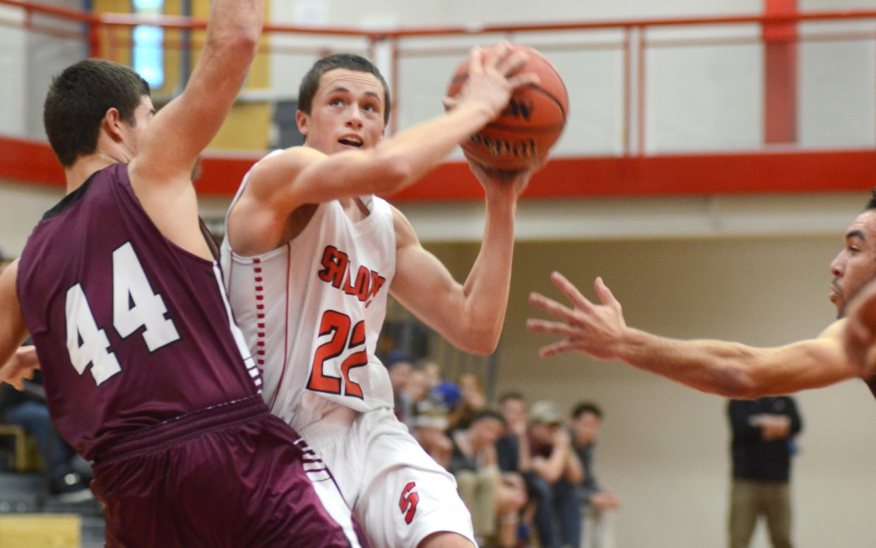Steamboat Springs senior Brody King drives the lane for a layup in the first half of the Sailors' 55-47 in on Saturday over Palisade.