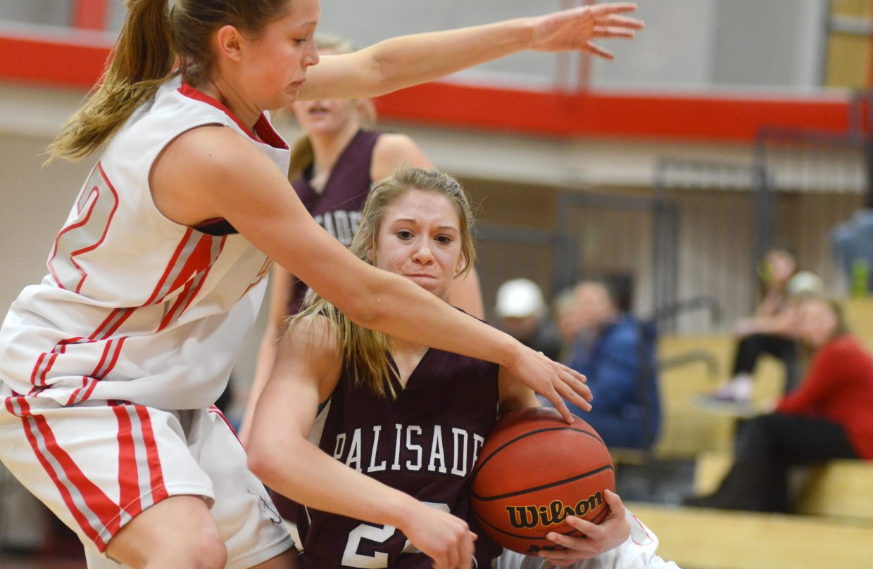 Steamboat Springs junior Maddie Clock smothers Palisade's Abby Thiessen in the second half of the Sailors' 50-32 loss at home Saturday.