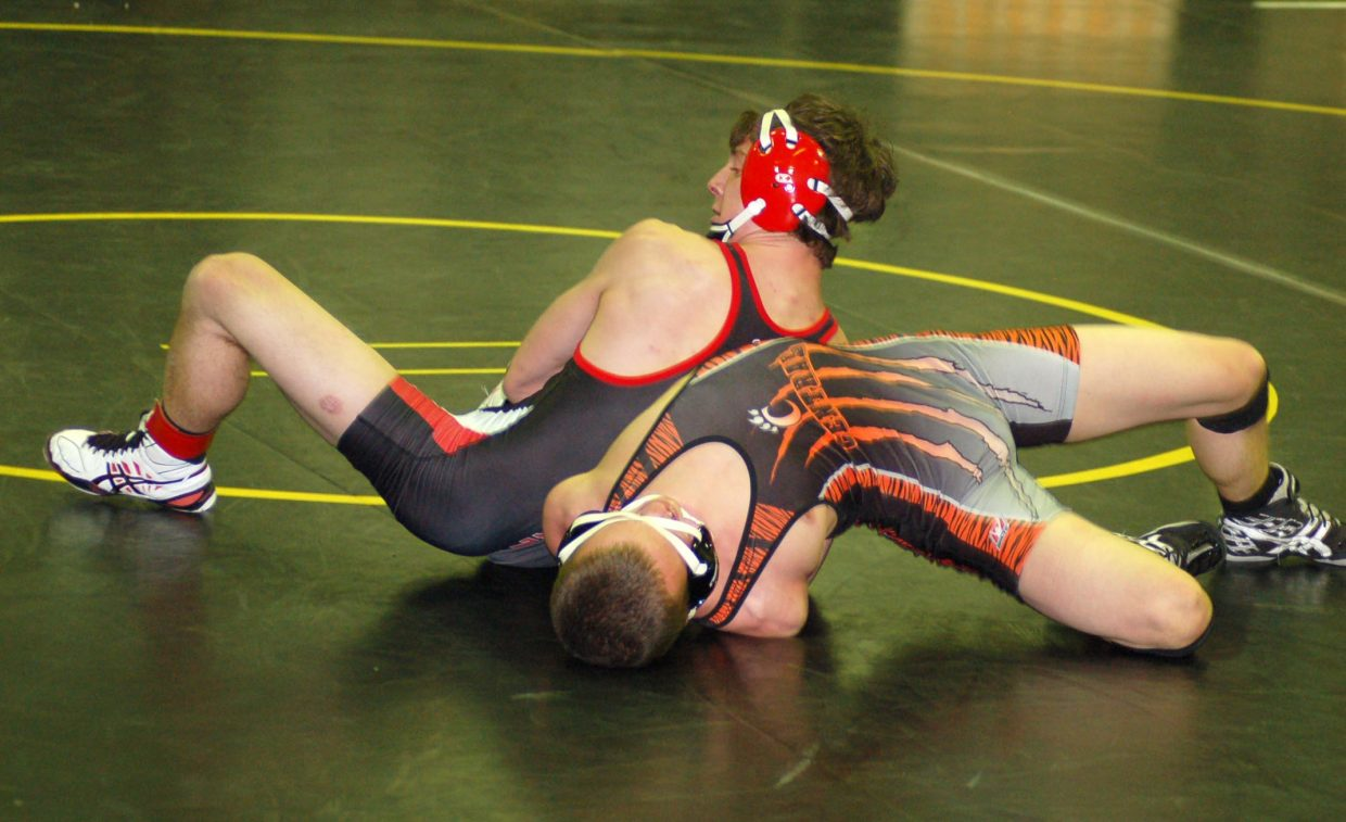 Steamboat Springs sophomore Matthew Hansen works his way toward a pin against his opponent from Central on Saturday at the Valley Tournament in Gilcrest.