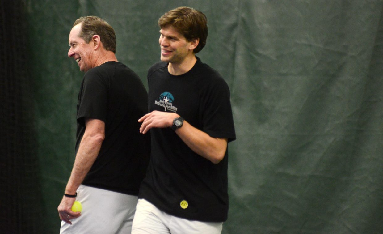 Tennis Center at Steamboat Springs Director Jim Swiggart, left, and Louis Nijsten laugh in between points during Saturday night's Battle of the Sexes. Swiggart and Nijsten played against Swiggart's wife, Stacy, and newest professional instructor Lilia Snape as a way to introduce Snape to the tennis community.