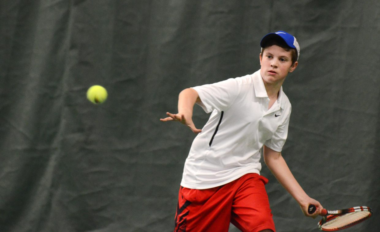John Hannaway returns a shot against Andy Schuiling in the intermediate boys singles championship Sunday.