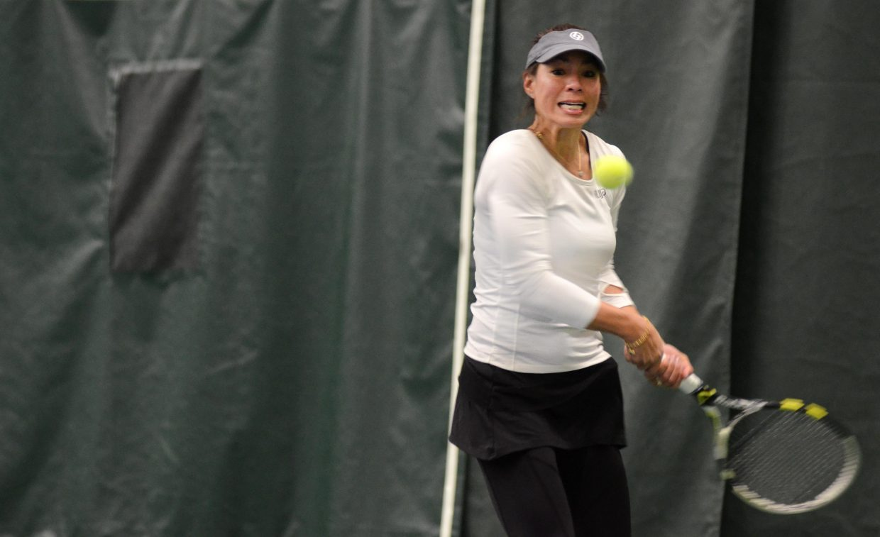 Tennis at Steamboat Springs instructor Lilia Snape returns a shot in Saturday night's Battle of the Sexes against Jim Swiggart and Louis Nijsten.