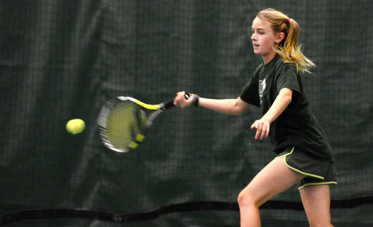 Mae Thorp gets into a shot on Sunday against Noelle Cerone in the advanced girls singles final.