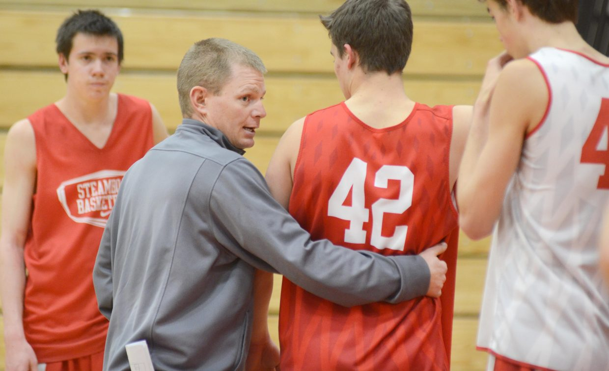 Steamboat Springs boys basketball coach Luke DeWolfe runs his players through a drill during Wednesday's practice. On Saturday, the Sailors will square off with Delta, a reeling program that loves to bring a physical game to the court.