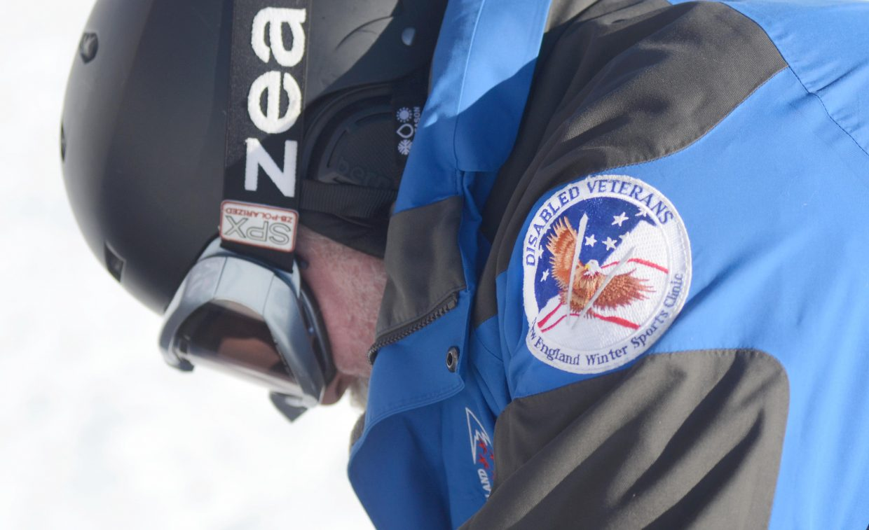 A patch on recreational sports coach Ralph Marche signifies the disabled veterans winter sports program he founded on the East Coast.