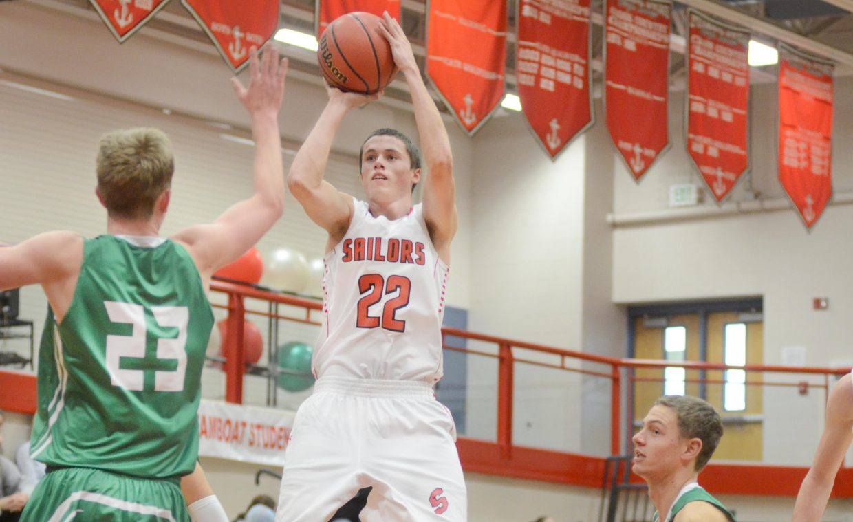 Steamboat Springs senior Brody King nails a jumper over Delta's Cade Gafford in the first half of the Sailors' 41-33 win Saturday. It was Steamboat's sixth straight win as the team enters the final stretch of the regular season.
