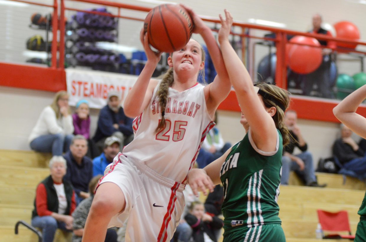Steamboat Springs junior Jenna Miller attempts a layup against Delta Saturday. Miller led the Sailors with a near triple-double effort, scoring 10 points with eight rebounds and 11 steals.