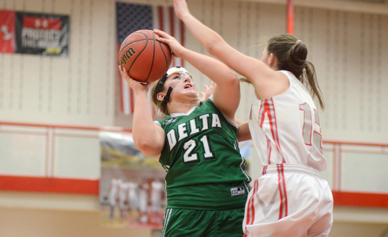 Delta's Lily Lockhart goes up for a jumper in the second half of Steamboat Springs' 52-33 loss on Saturday. The two teams combined for 58 turnovers, but it was the Panthers that hit big free throws and shots down the stretch.
