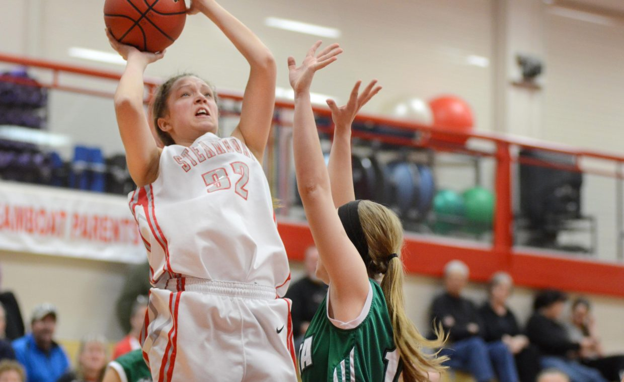 Steamboat Springs junior Maddie Clock tries to shoot over Delta's Joyclie Webb in the first half of the Sailors' 52-33 loss on Saturday.