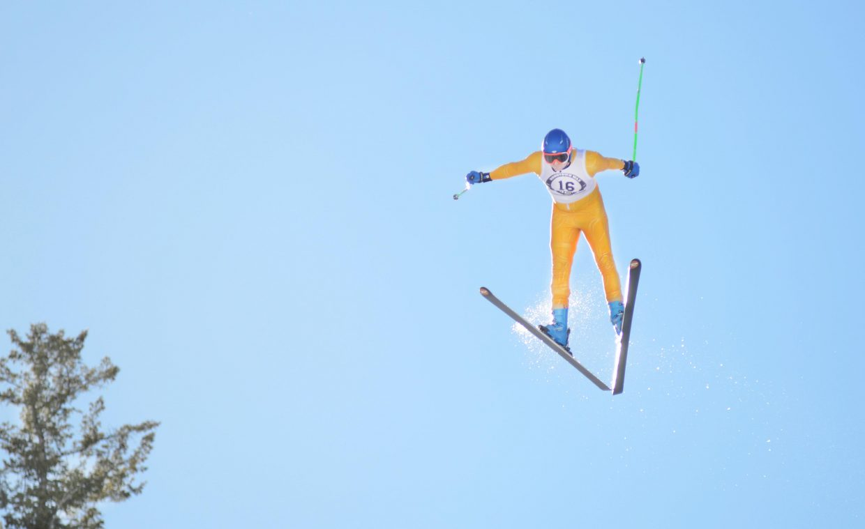 Tyler Erickson gets up during his second jump of Sunday's Winter Carnival Pro Alpine ski jumping finals at Howelsen Hill.