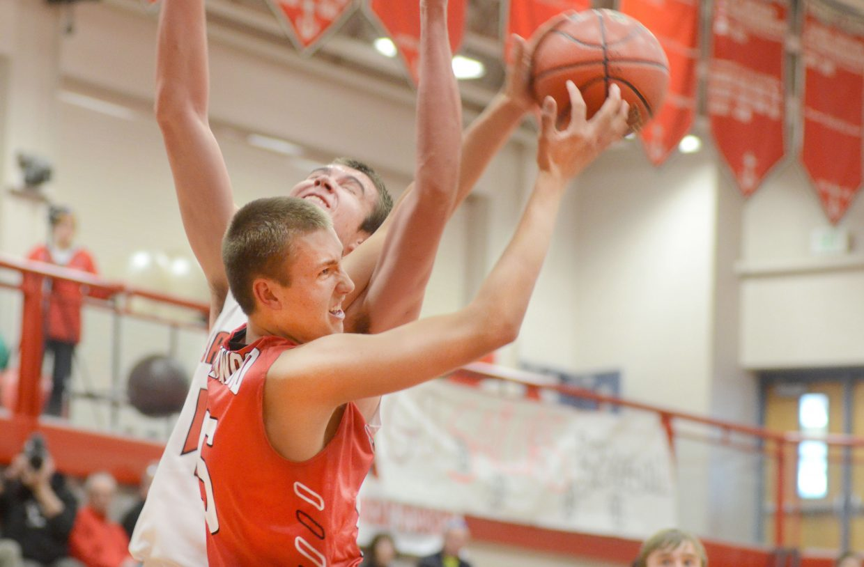Steamboat senior Garrett Bye and Glenwood senior Zack Peterson fight for a rebound during the Sailors' and Demons' game Jan. 17. Glenwood finished off Steamboat with a 45-38 win, but the Sailors get a chance to snag a share of the 4A Western Slope League championship Saturday.