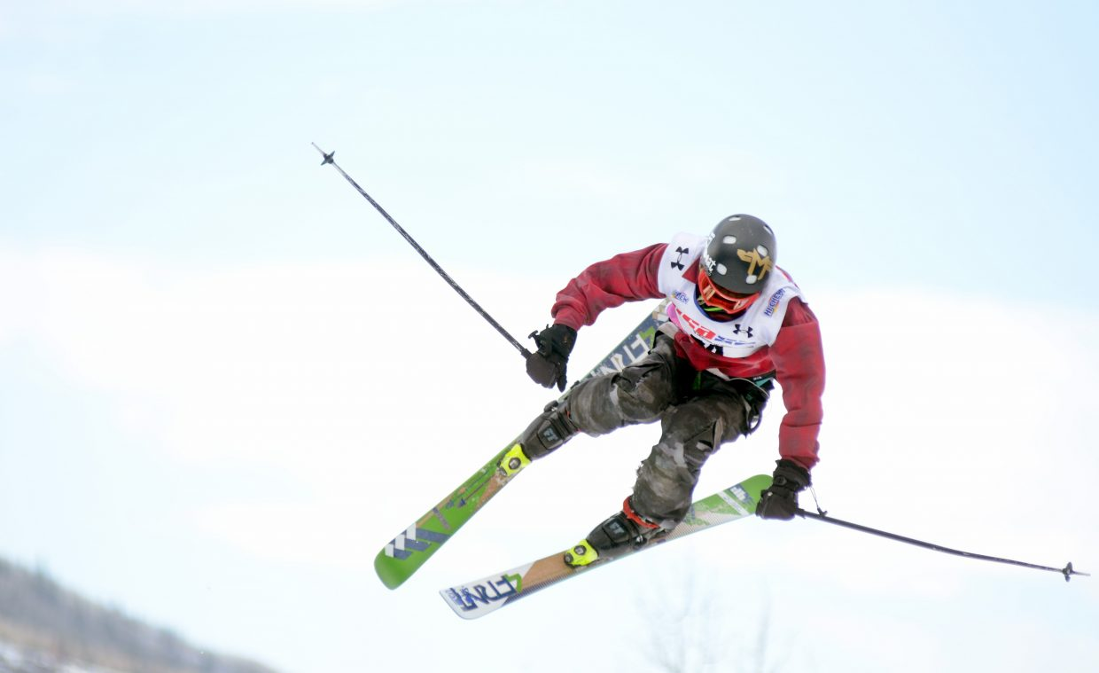 Steamboat Springs' Payton McElhiney gets in a trick on Steamboat Ski Area's Mavericks Terrain Park Sunday during a USASA slopestyle competition. McElhiney won the men's 13-15 age division, continuing his ascent on the freeskiing circuit.