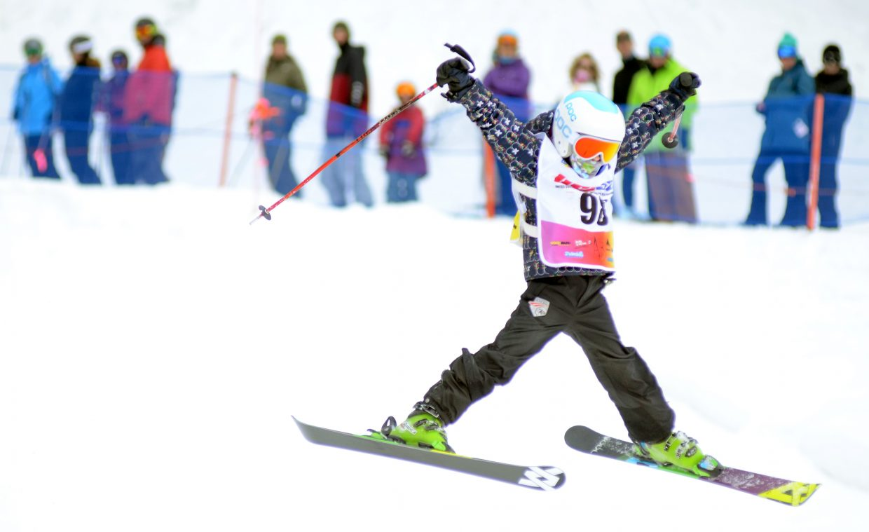 Liv Moritz, skiing out of Edwards, throws down a trick during her second run in the girls' 10-12 age class.