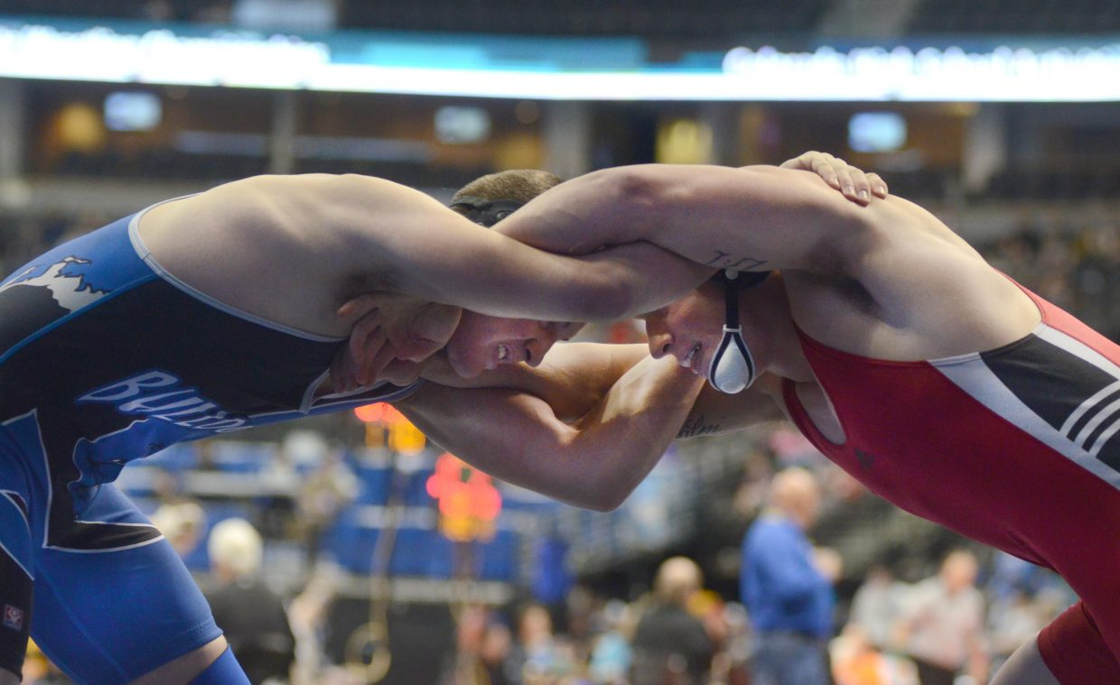 Moffat County's Stelios Peroulis hung on to beat Strasburg's Jacob Smith, 4-2, in the prelims round of the 3A state wrestling championships on Thursday.