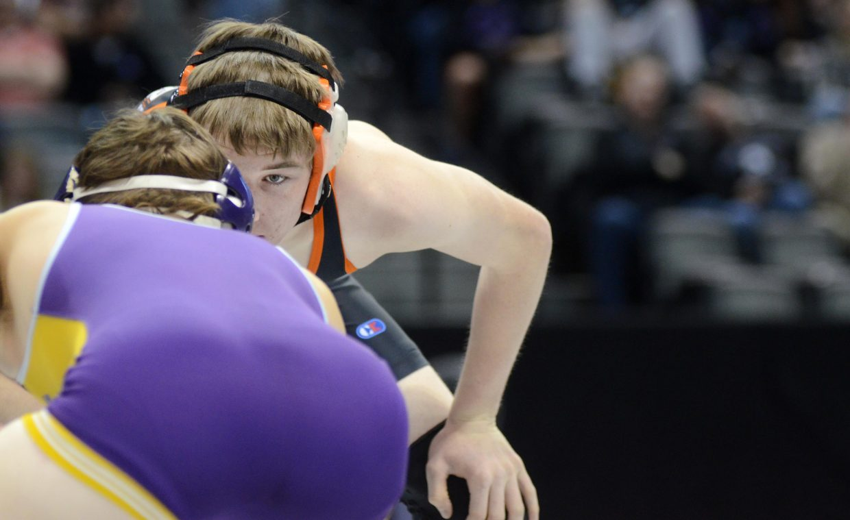 Hayden senior Kent Miller stares down Eads' Reagan Lane in the championship quarterfinal round of the 2A state wrestling championship on Friday.