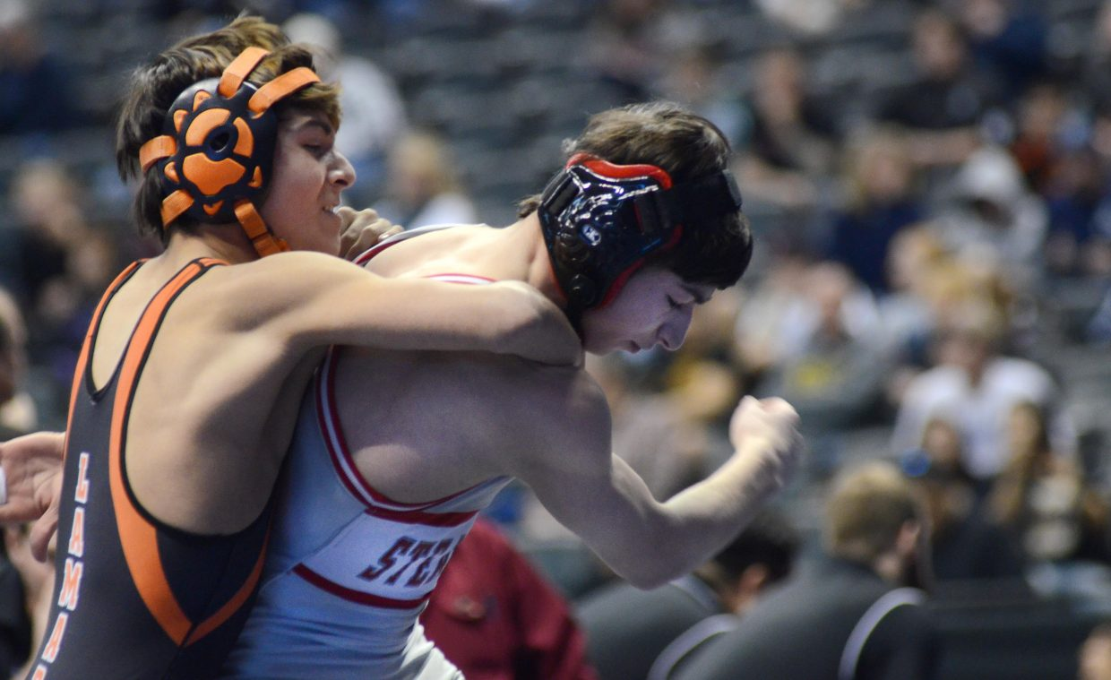 Steamboat Springs sophomore Colton Pasternak tries to avoid the takedown from Lamar's Justin Batterton in the consolation quarterfinal round of the 3A state wrestling championships on Friday.