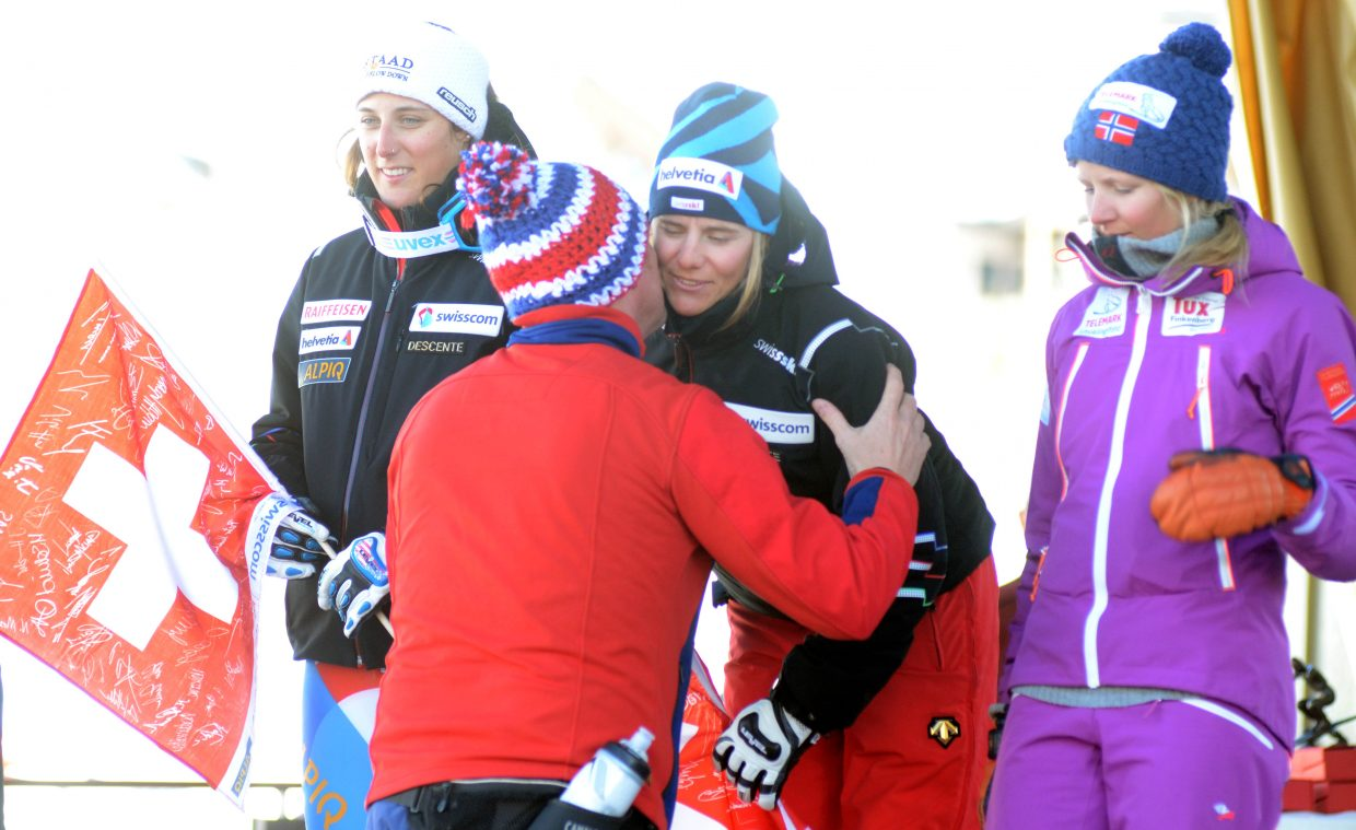 FIS Telemark Skiing President Andrew Clarke greets Switzerland's Amelie Reymond Friday, the winner of the World Championships' elite women's classic race.