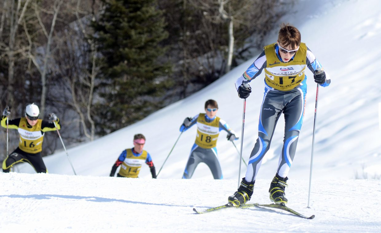 Alaska Division's Eli Hermanson slides ahead of his pack of competitors in the U16 men's Nordic combined class Thursday.