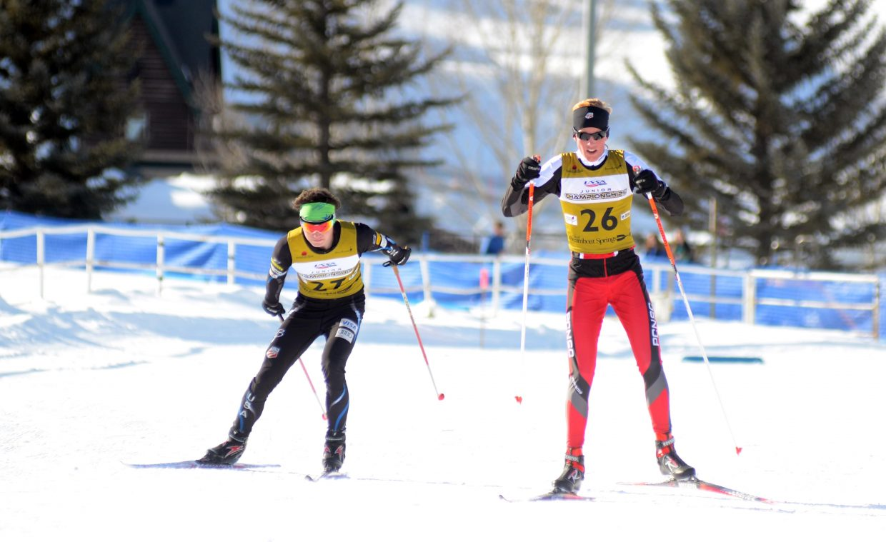 Rocky Mountain Division's Nicholas Madden, left, and Intermountain Division's Somer Schrock come down the final stretch of Lap 1 during their thrilling U20 men's Nordic combined Junior Nationals race on Thursday. The two exchanged leads throughout the three-lap course, but it was Madden who outlasted Schrock for the Nationals victory.