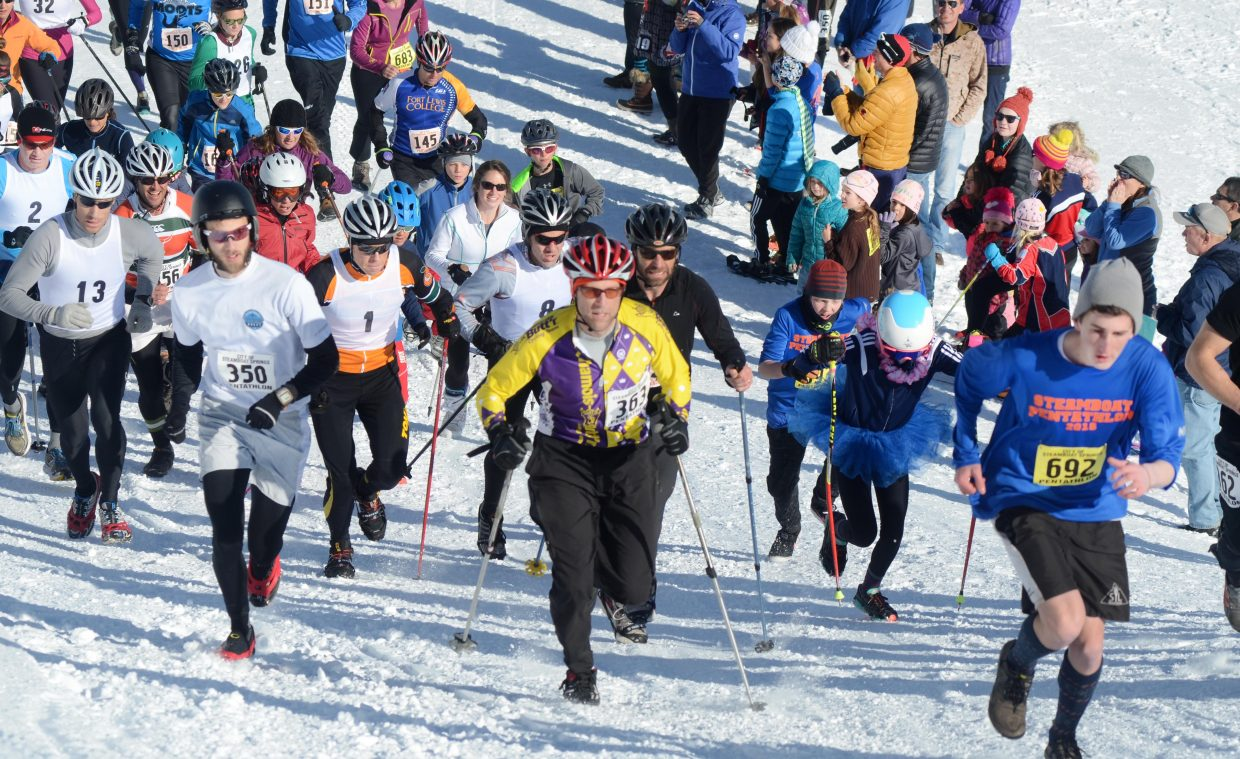 Steamboat Pentathlon racers storm up Howelsen Hill for the first leg of this year's 24th running of the annual event.