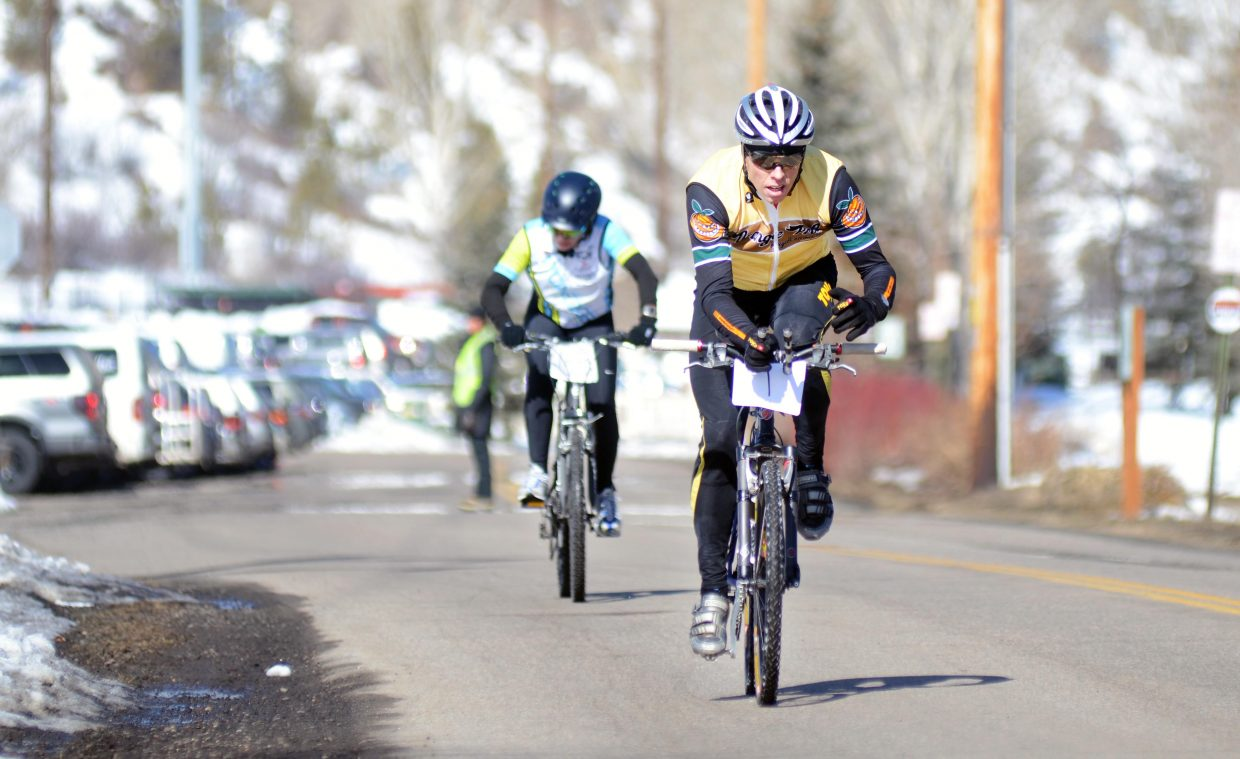 Barkley Robinson races down Howelsen Parkway during the biking leg of the 24th annual Steamboat Pentathlon on Sunday.