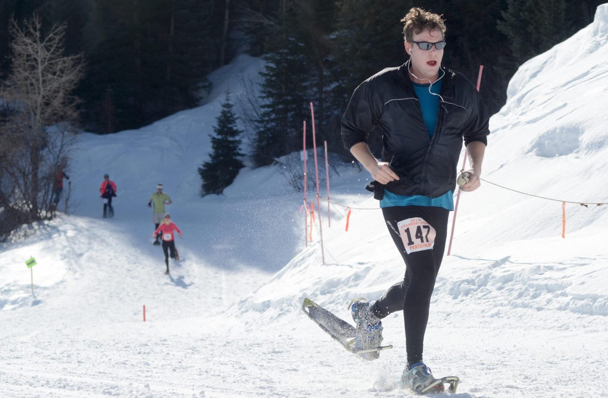 James Eichenberger comes down the final stretch of the snowshoe leg of the 24th annual Steamboat Pentathlon on Sunday.
