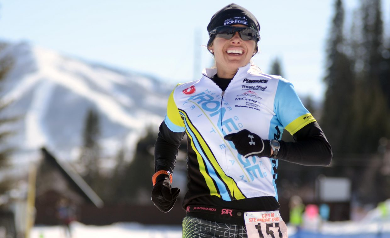 Heather Gollnick smiles as she crosses as the women's short course individual winner in Sunday's Steamboat Pentathlon.