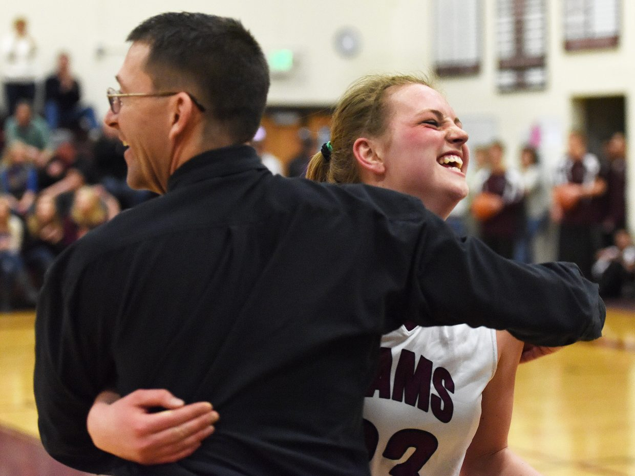 Soroco senior Jessica Rossi celebrates with Rams girls basketball coach David Bruner following the team's Jan. 31 home win over West Grand. Rossi was elected to play in this Sunday's Colorado Coaches of Girls Sports All-State basketball game at Arvada West High School. Rossi also verbally committed to play basketball at Eastern Wyoming College next year.