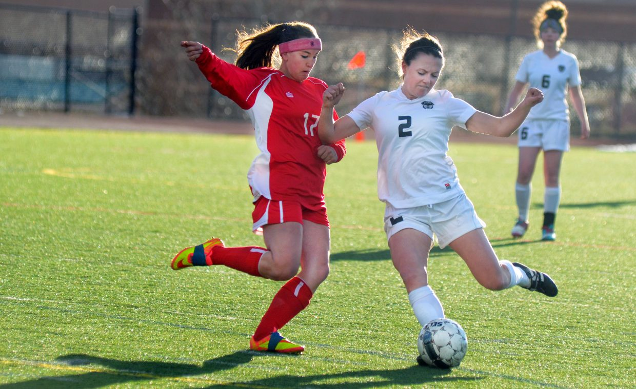 Steamboat Springs junior Jordi Floyd nails a shot past Glenwood Springs' Eryn Peterson in the first half of the Sailors' 5-1 victory over the Demons Thursday night at Gardner Field. Floyd poured in a hat trick, helping Steamboat grab its biggest win of the season thus far.