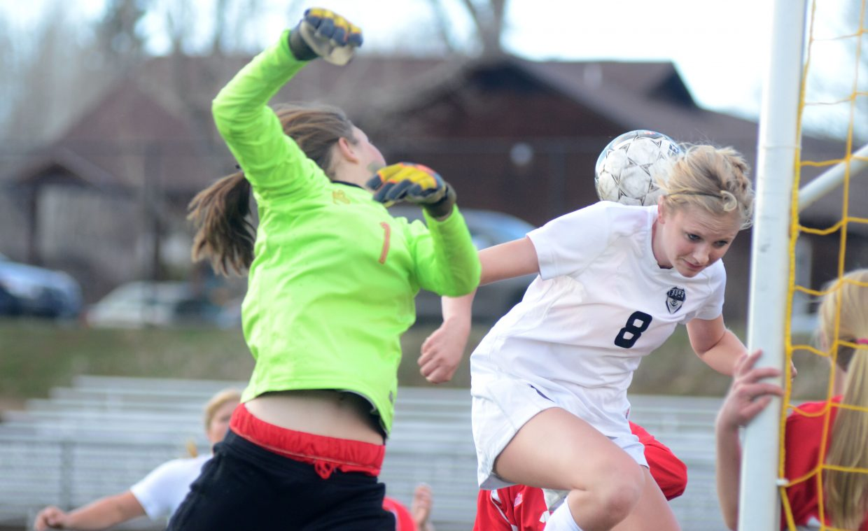 Steamboat Springs' Maggie Henry, No. 8, nearly punches in a header goal in the first half of the Sailors' 5-1 win over Glenwood Springs on Thursday.