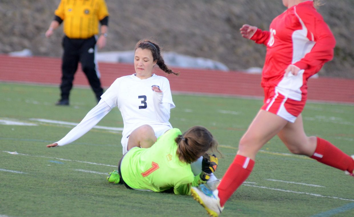 Steamboat Springs senior Eliza Leeson slides into Glenwood Springs goalie Erin Bucchin in the second half of the Sailors' 5-1 win on Thursday.