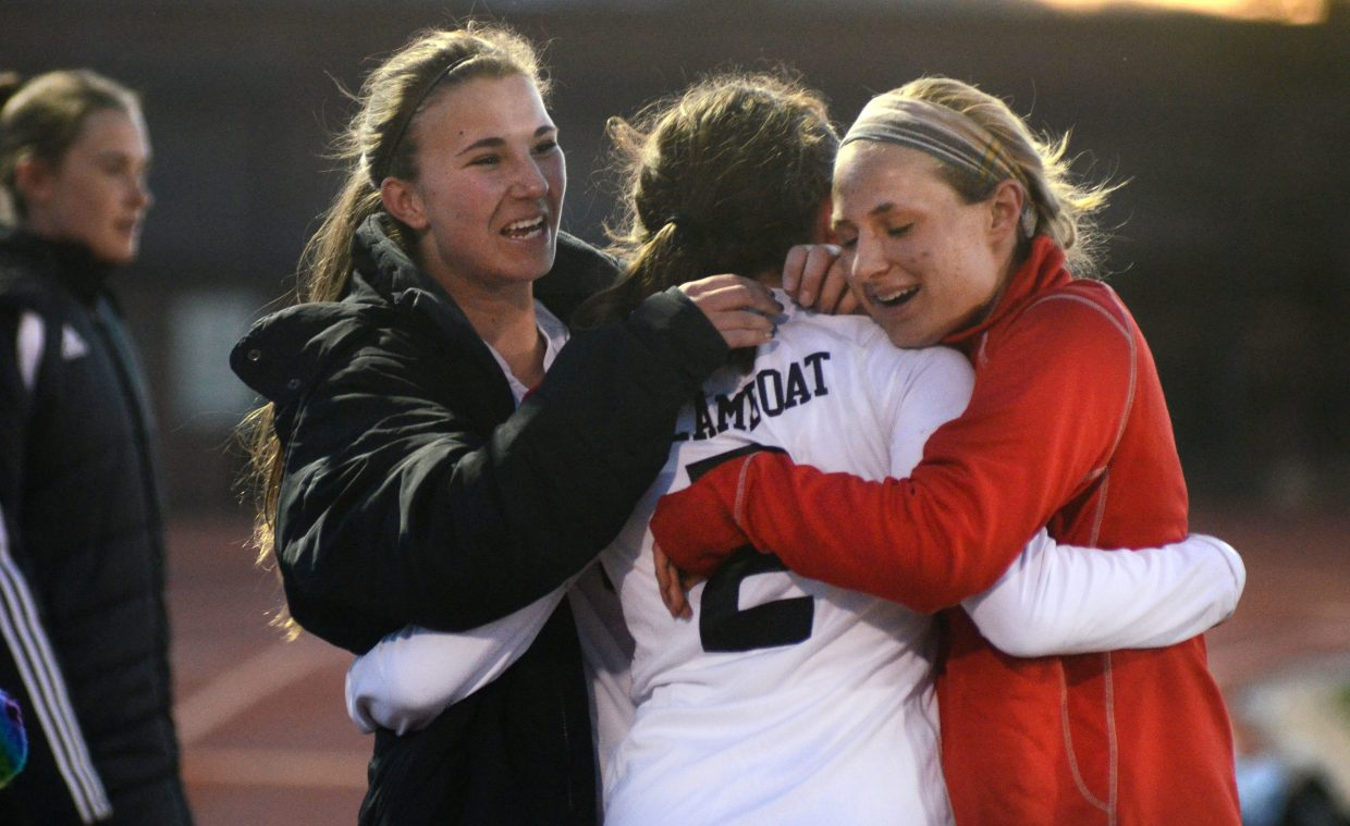 Steamboat Springs High School girls soccer players Savannah Bauknecht, left, and Lauren Anderson, right, congratulate junior Jordi Floyd after she's pulled off the field Thursday night versus Glenwood Springs. Floyd scored a hat trick and guided the Sailors to their biggest win so far this spring, 5-1.