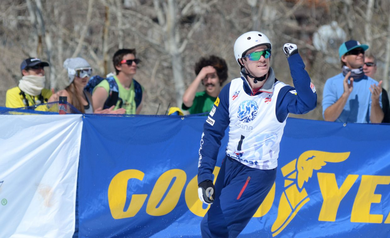 Mac Bohonnon pumps his fist after his finals-round jump in Saturday's U.S. aerials men's championship. Bohonnon had every reason to celebrate. The newly turned 20-year-old ran away with the day's best score and his career-best score, 129.41, for gold.