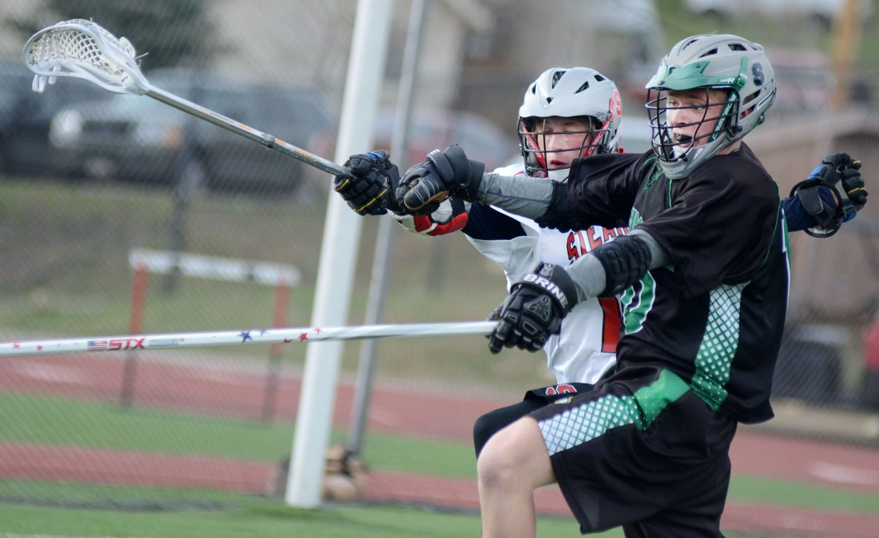 Steamboat Springs High School junior lacrosse player Jackson Draper races a Summit player to gain possession late in the Sailors' 8-7 win Thursday night at Gardner Field. Draper poured in a game-high four goals as Steamboat edged the Tigers for their second conference victory.